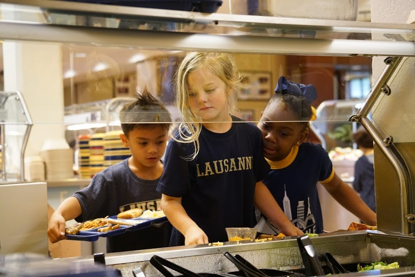 Three students in buffet line