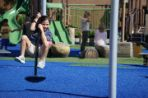 Student swinging on playground