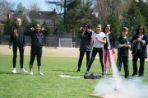 Group of students watching a rocket take-off